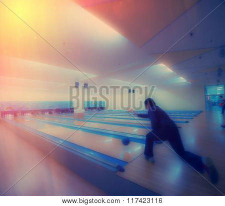 Man Resting In A Bowling Hall