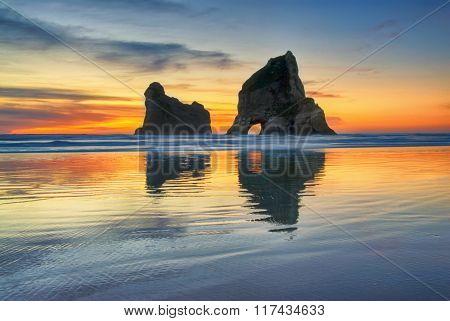 Sunset at Wharariki beach, New Zealand