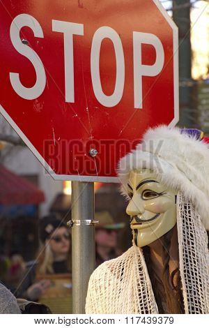 Guy Fawkes Mask By Stop Sign