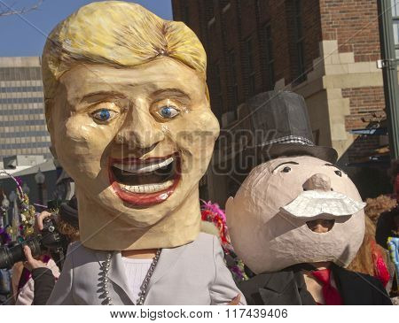 hillary and the monopoly man do mardi gras