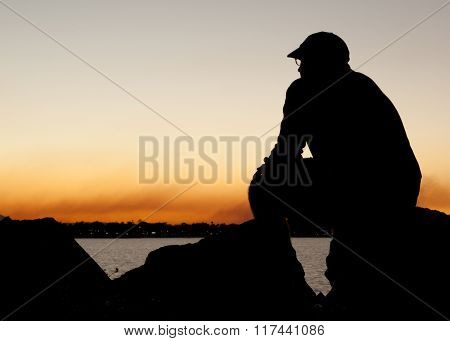 Man in silhouette at sunset
