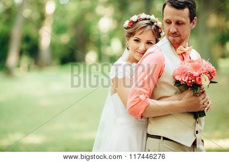 Bride And Groom At Wedding Day Lovely Hugging Outdoors On Green Nature.