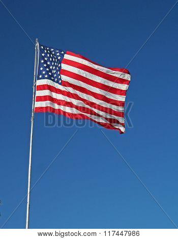 American Flag Against Clear Blue Sky
