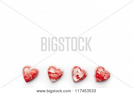 Red and white heart chocolates in line  copy space