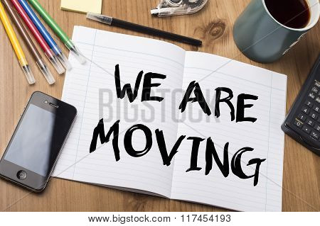 We Are Moving - Note Pad With Text On Wooden Table