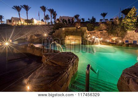 Long exposure shot of swimming pool at luxury night illumination