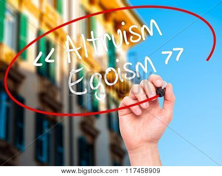 Man Hand Writing Altruism - Egoism With Black Marker On Visual Screen.