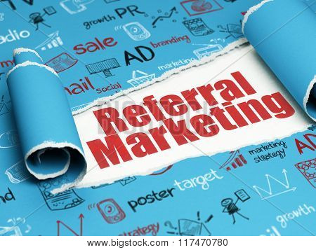 Marketing concept: red text Referral Marketing under the piece of  torn paper