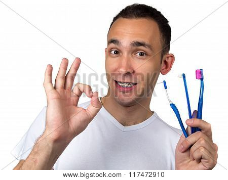 Man showing okey with toothbrushes