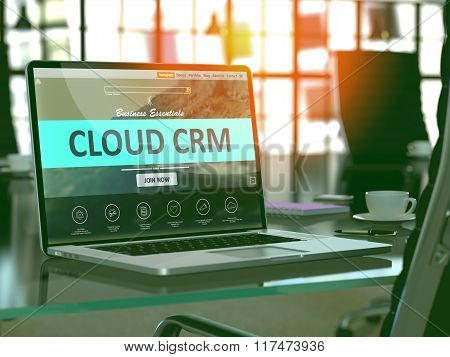 Cloud CRM  on Laptop in Modern Workplace Background.