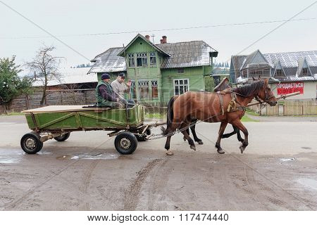 Vorokhta, Ukraine - October 13, 2015: Local Residents Ride In A Cart On A Rural Road