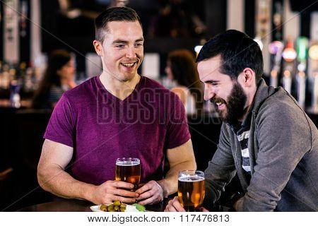 Friends having a pint in a bar