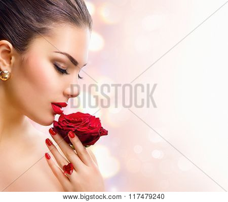 Beauty Woman with red rose. Fashion Model Girl face Portrait with Red Rose in her hand. Red Lips and Nails. Beautiful Luxury Makeup and Manicure