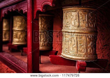 Buddhist prayer wheels in Thiksey gompa (Tibetan buddhist monstery). Ladakh, India