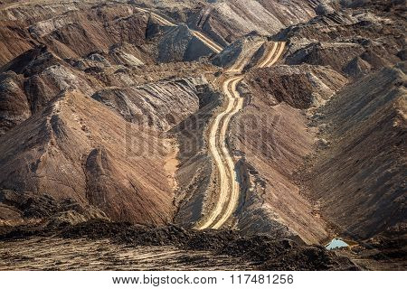 Large excavation site with roads ahead