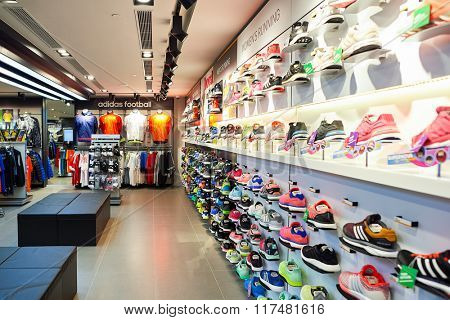 HONG KONG - NOVEMBER 02, 2015: an Adidas shop in New Town Plaza. Adidas AG is a German multinational corporation that designs and manufactures sports shoes, clothing and accessories