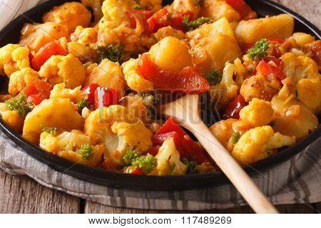 Indian Cuisine: Gobi Aloo Close-up On A Plate. Horizontal