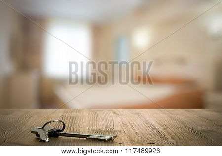 keys on wooden table in the bedroom