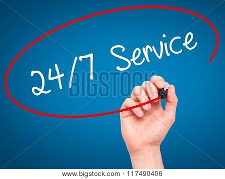Man Hand Writing 24/7 Service With Black Marker On Visual Screen
