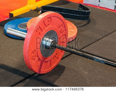 Closeup Of Fitness Equipment In Gym: Barbell With Plates