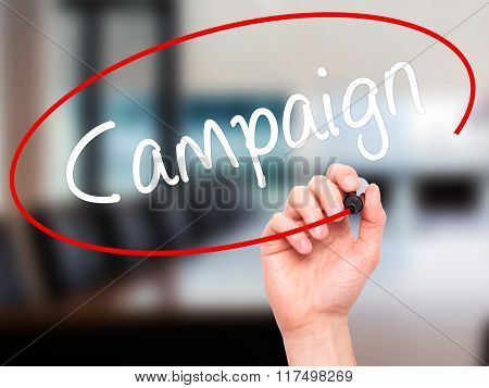 Man Hand Writing Campaign With Black Marker On Visual Screen