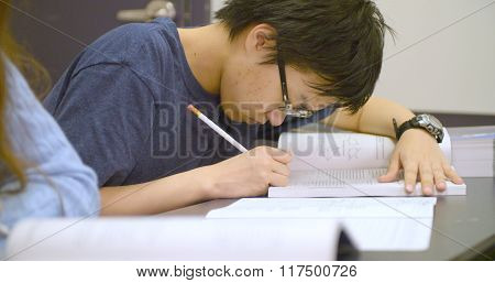 Student studies for SAT standardized test