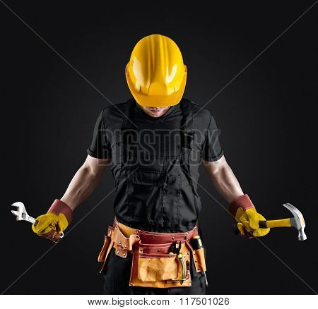 construction worker in helmet with hammer and wrench