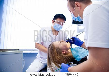dentist treats teeth