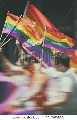 Participants waving flags at the New York LGBT parade