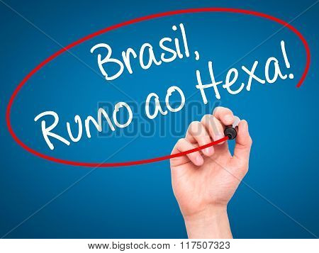Man Hand Writing Brasil, Rumo Ao Hexa! With Black Marker On Visual Screen.