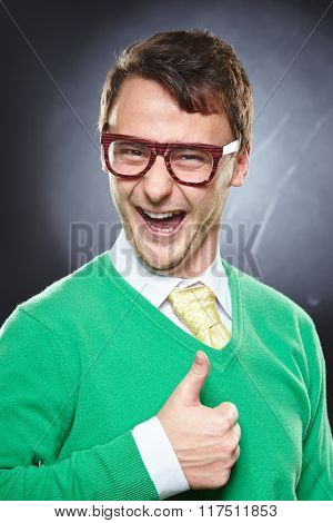 Nerd young man showing thumbs up