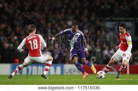 LONDON, ENGLAND - NOV 04 2014: Arsenal's Nacho Monreal Oswal ���lvarez of Anderlecht and Arsenal's Mikel Arteta during the UEFA Champions League match between Arsenal from England and Anderlecht