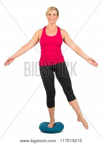 Middle Age Woman On Proprioceptive Pillow