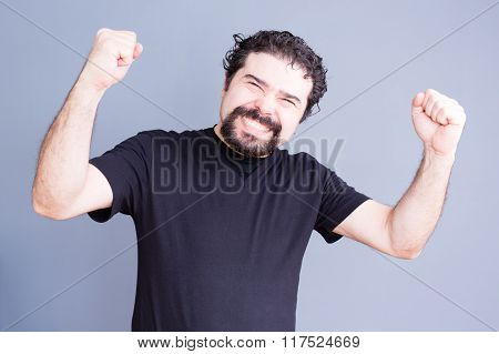 Elated Man With Fists Held Up
