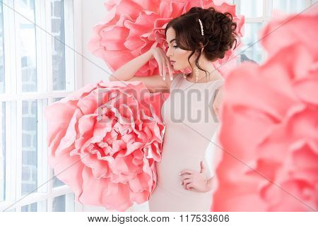 Beautiful Sexy Girl In A Long Dress With A Huge Pink Flowers.