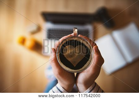 Girl Holding A Cup Of Coffee With Heart Symbol.
