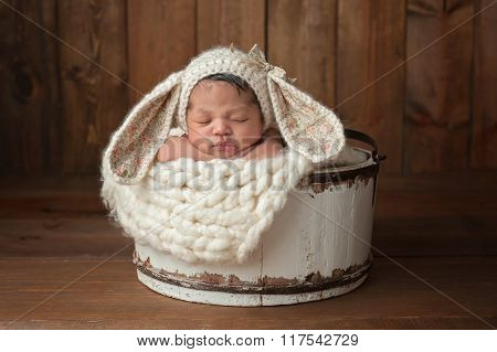 Newborn Girl Wearing A Bunny Bonnet