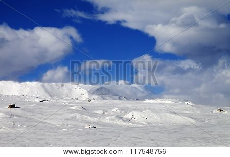 Ice-covered Slope And Snowy Mountains In Fog