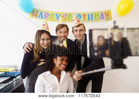 Business People Taking Selfie With Phone At Office Party