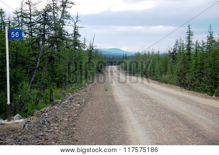Kilometer post at taiga gravel road Chukotka Russia poster