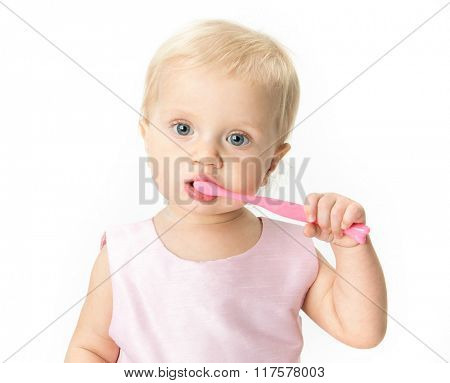 little child baby brushing teeth brush face isolated on white studio shot