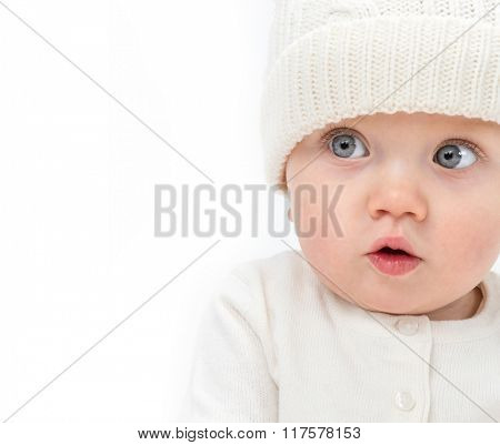 little child baby smiling  warm clothing hat isolated on white studio shot