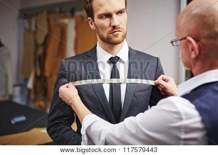 Businessman visiting tailor