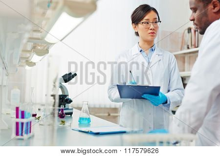 Biochemists in lab