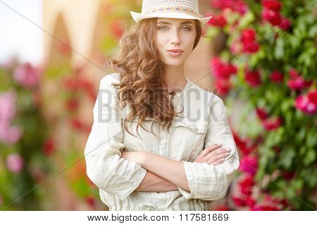 Woman in Tuscany garden. Summer in Italy