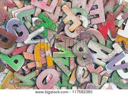 old wooden letters in a pile