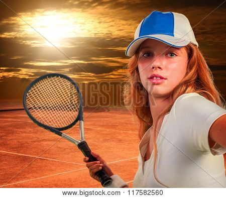 Girl in cap holding tennis  racket on sun sky with clouds.