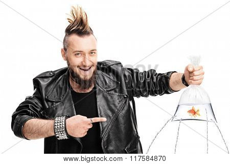 Evil male punk holding a goldfish in a bag with holes poked in it and the water leaking isolated on white background