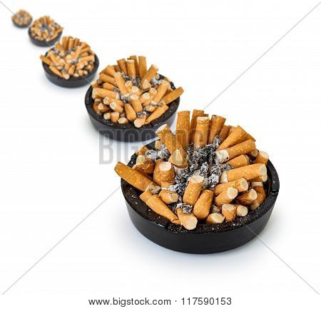 ashtray full of cigarette butts on a white background