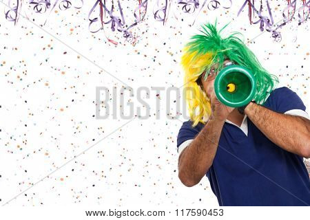 Brazilian guy blowing vuvuzela at Carnival from bottom right corn